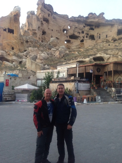 Both of us with cave homes in the back ground.