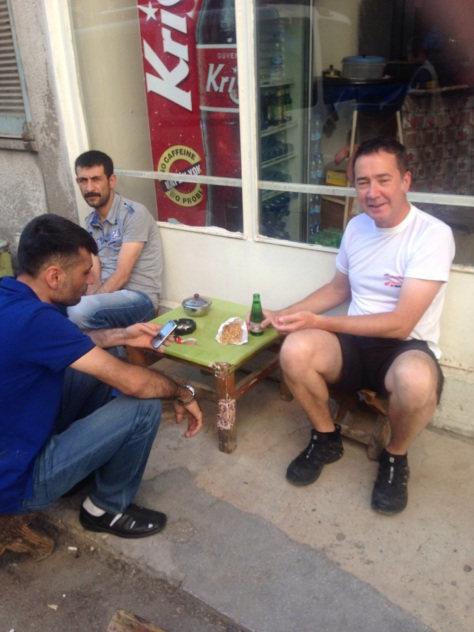 David being taken out by locals for nuts and a special drink to cure his tummy.