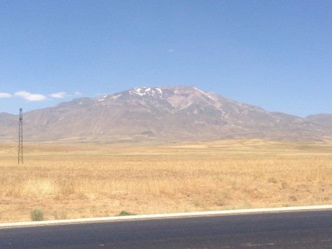 This  picture of a snow covered mountain was taken while riding in 31deg heat and sweat running off me! Odd sensation.