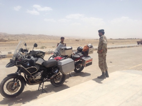 Stopped at a Pakistan military check point in the desert. Looks hot? Yes it was.