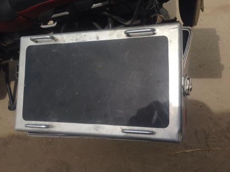Steve's pannier box after a confrontation with a bus