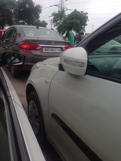 No this is not a parking lot, it's typical Delhi traffic, note the folded back mirrors. Who needs them?