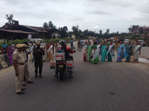A group of Indian ladies protesting by blocking a road. The authorities were reluctant to tell us why?