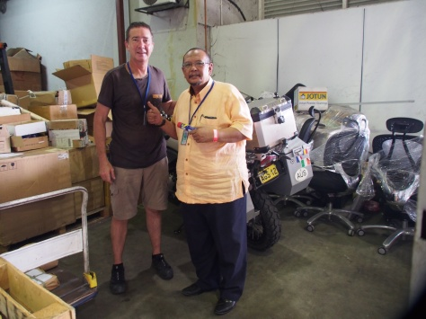 Handing the bike over to Sham from Freight Forwarding Co.