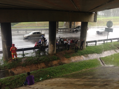 Hiding under an overpass with several other bikers